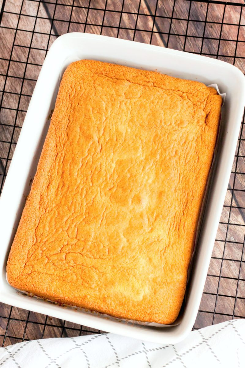 The cake is on a cooling rack after it has been fully baked.