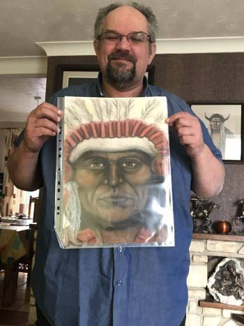 Shane proudly holding with his Lee-Anne Higgs A3 Spirit Guide portrait