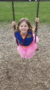 smiling skyler swinging