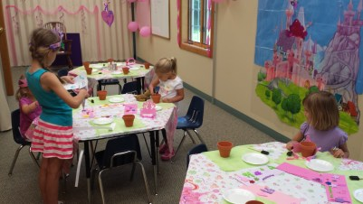 girls painting pots