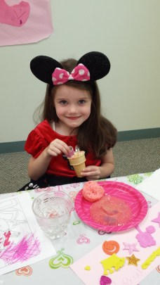 Little Minnie Mouse Maggie enjoying her ice cream cone.