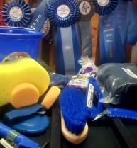 Bucket, hoof pick, hard brush, mane comb, hoof pick, horse treats, helmet cover, polo wraps, bath sponge, two tack sponges, saddle pad