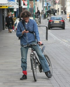 bicyclist-texting-in-street-for-site
