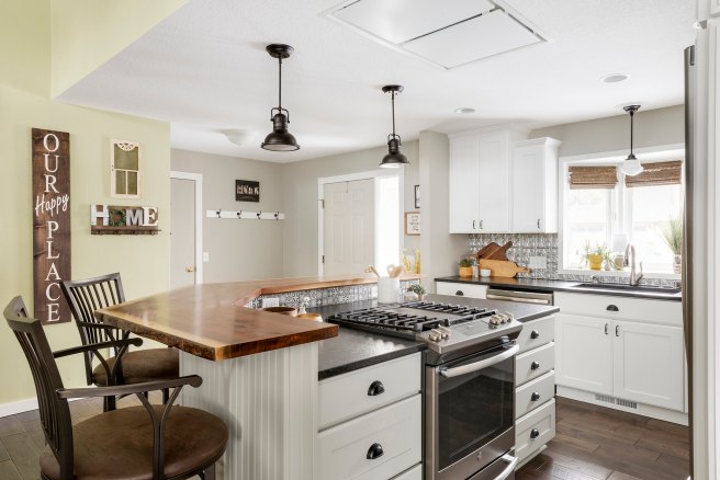 Kitchen remodel by White Birch Design, A Lakeville MN based remodeler  Featuring A Two Tier Kitchen Island