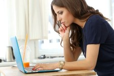 Image of woman working at a computer