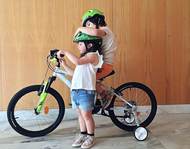 On his bicycle with his sister just before going for a spin
