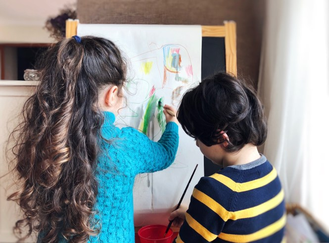 Siblings painting together