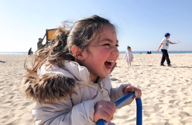 Playing at the beach - the joy of laughter