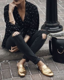 gold mules, black jeans, polka dot shirt