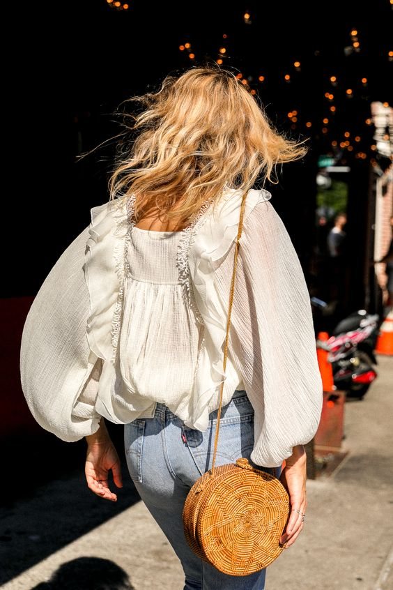 woven handbag, jeans and white floaty blouse