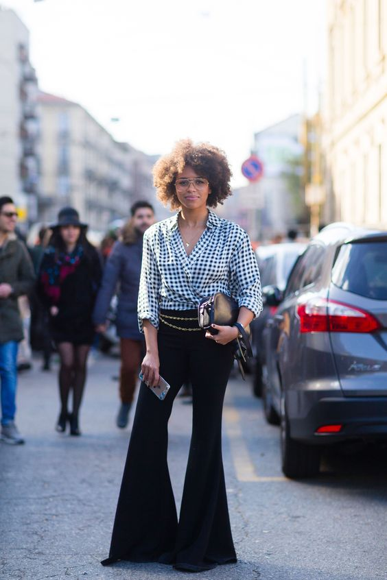 Flare black trousers, chain belt, check blouse