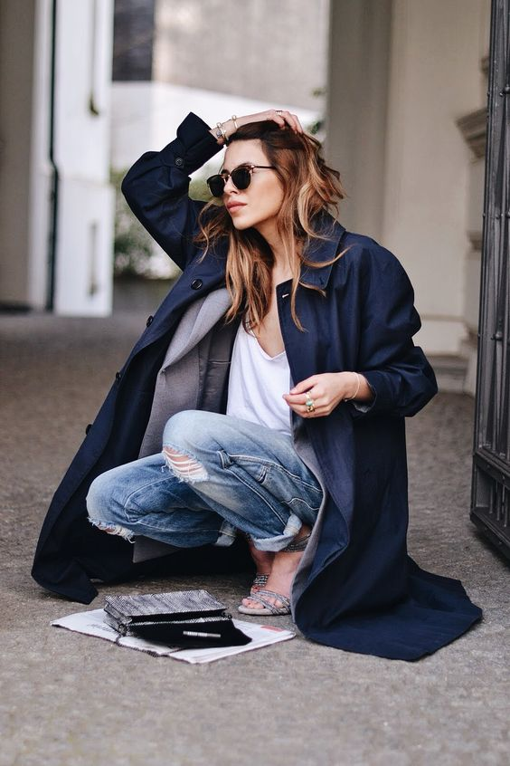 trench coat layered over blazer