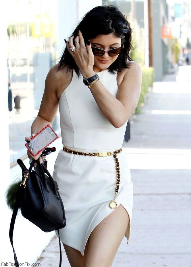 white dress and chain belt