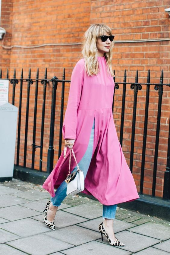 pink dress over blue denim jeans