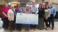 White Eagle presented a check for $2500 to Jane Mathias of the Augusta Historical Society on Tuesday afternoon.