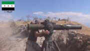 A Free Syrian Army fighter operates a TOW missile.