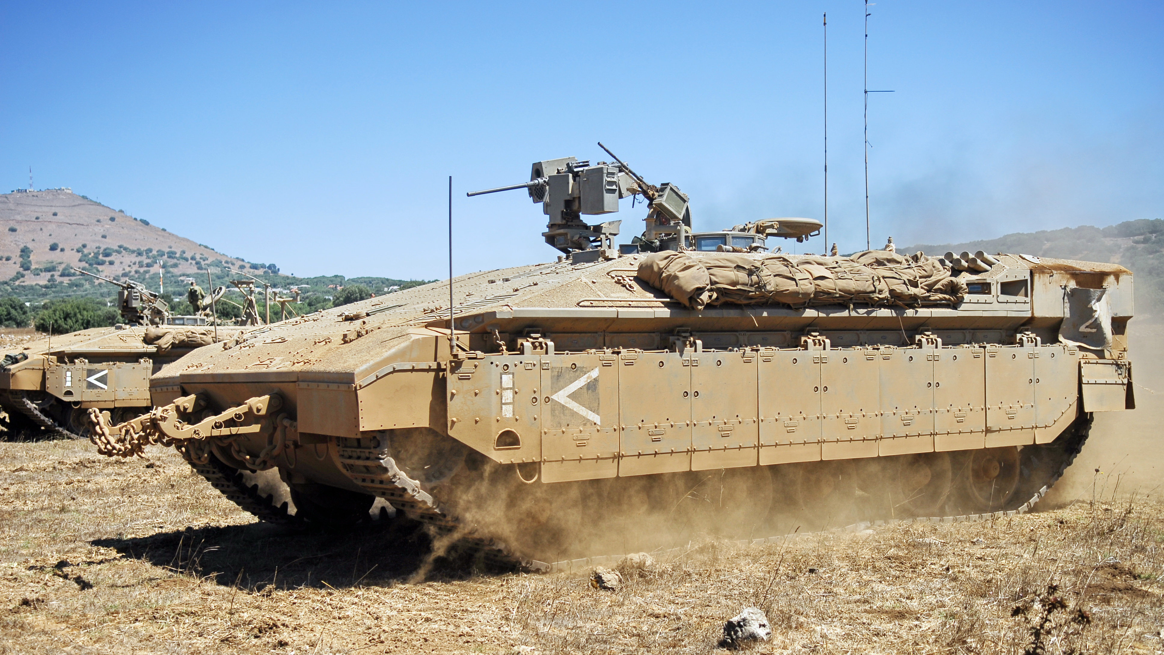 Despite its large size and heavy armor, the Israeli Namer APC is classified as an APC because it lacks the powerful armaments possessed by tanks and IFVs.