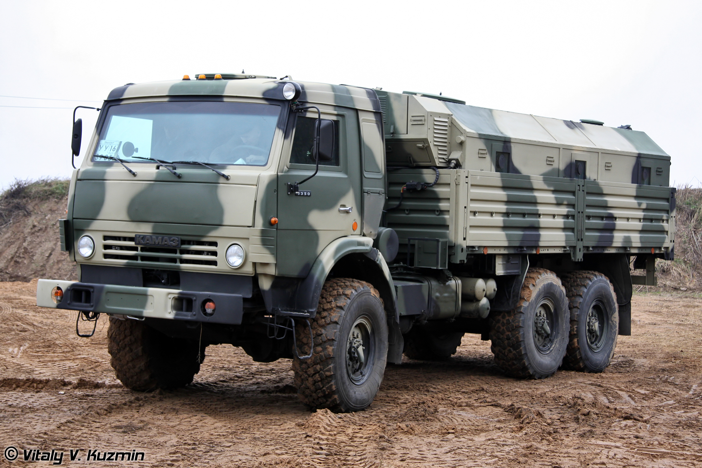 A Russian-made Kamaz 5350 medium truck. Note the cosmetic similarities to a civilian medium truck. Military trucks generally have superior off-road mobility to civilian trucks, hence the knobby mud tires.