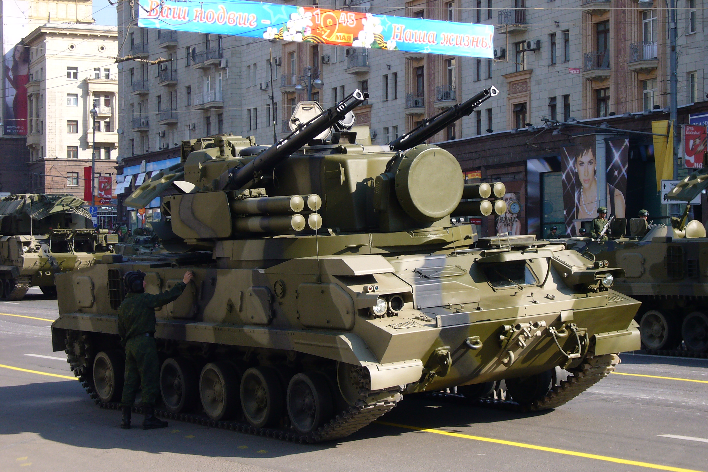 This Russian Tunguska SPAAG is armed with autocannons and anti-air missiles. Clearly visible on each side of the turret are the missile tubes. The circular object on the front of the turret is a radar antennae.