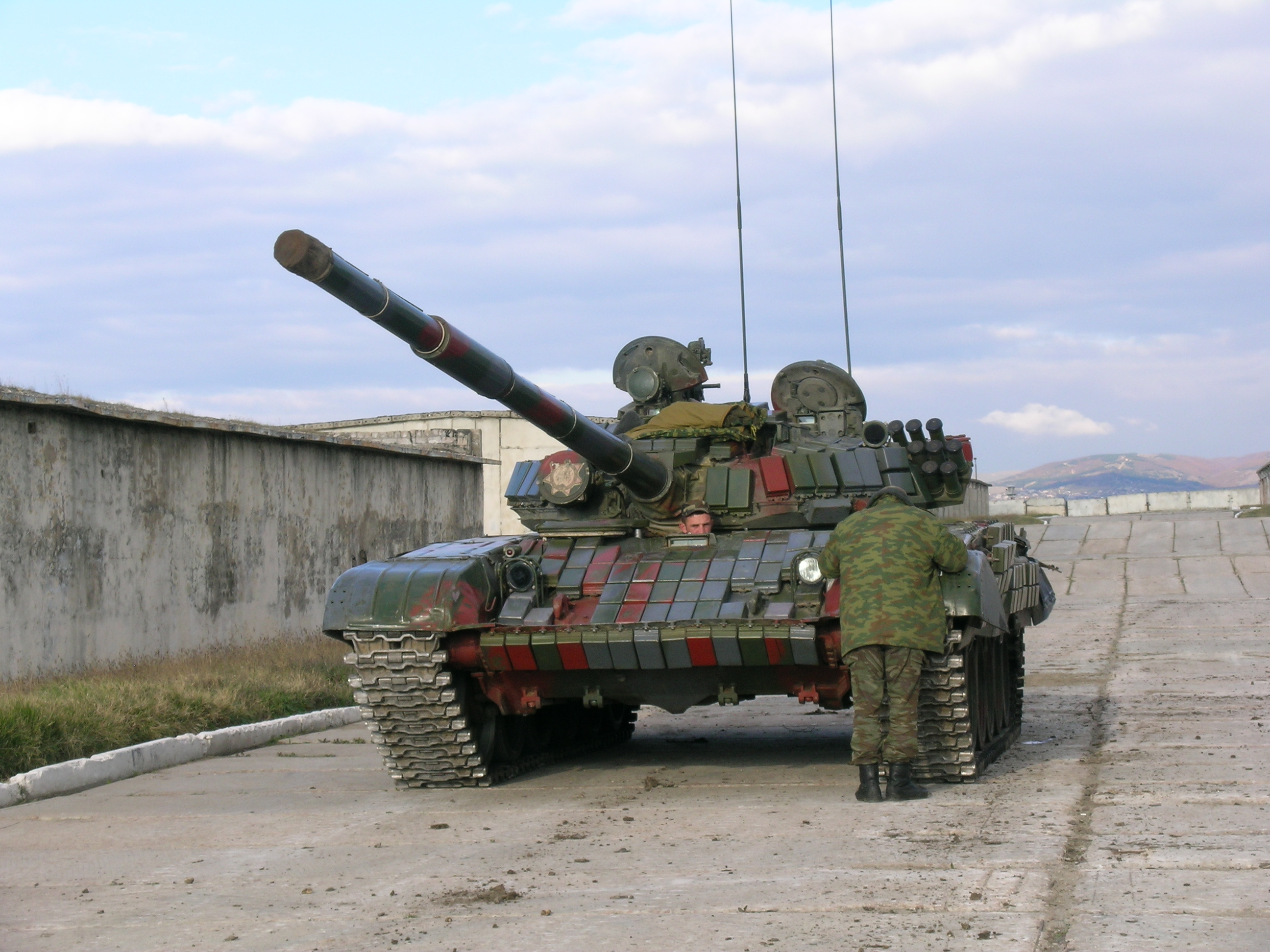 This T-72 tank is covered in ERA bricks.