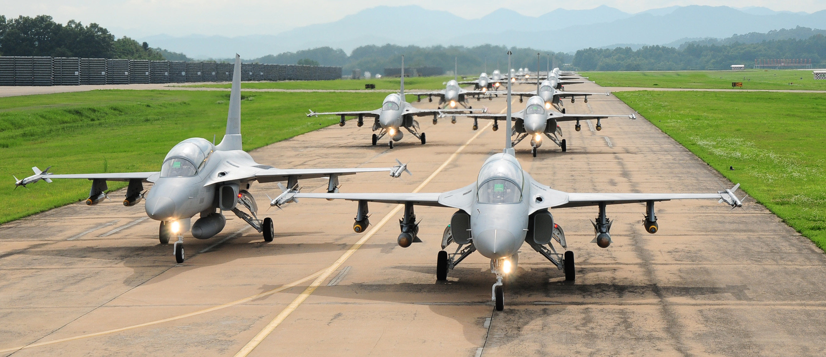 Korean TA-50 trainer/light attack aircraft taxi on a runway.