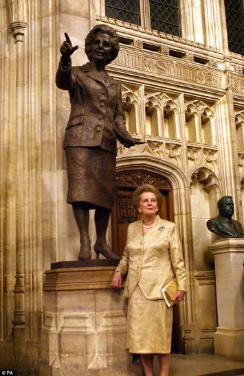 {MT in front of a bronze statue of herself, inside the Palance of Westminister, London in 2007}