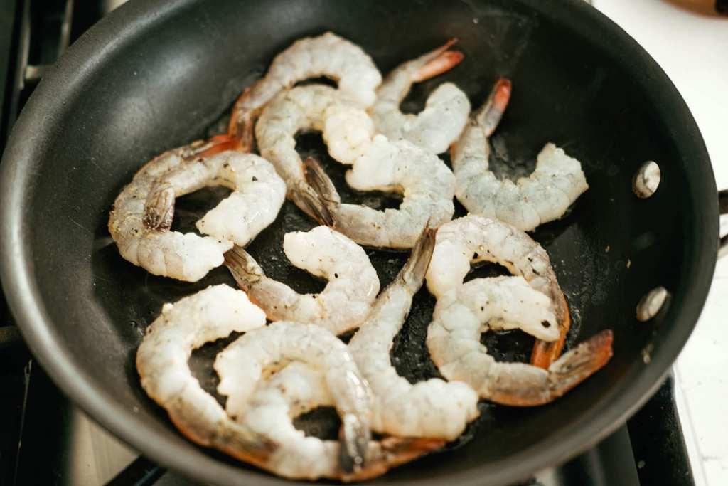 cooking red Argentinan shrimp in a skillet