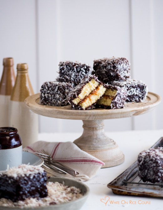 Australian Lamington cake recipe- sponge cake filled with jam, dipped in chocolate and dried coconut from White on Rice Couple