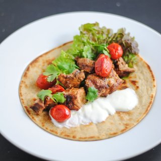 Southwest pork kebabs with grilled tomatoes and yogurt sauce