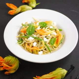 Summer pasta with squash blossoms and goat cheese