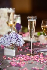 Champagne glass next to blue hydrangea