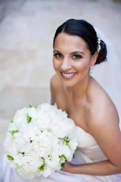Bride with a peony and fresia bouquet
