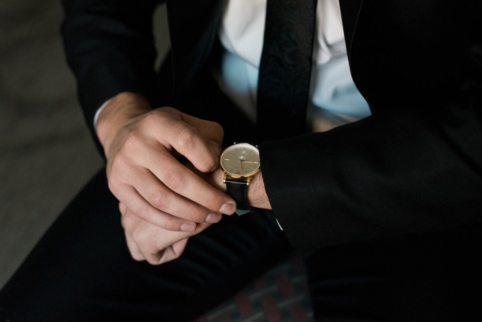 Groom admiring his new watch gifted to him by his future wife.