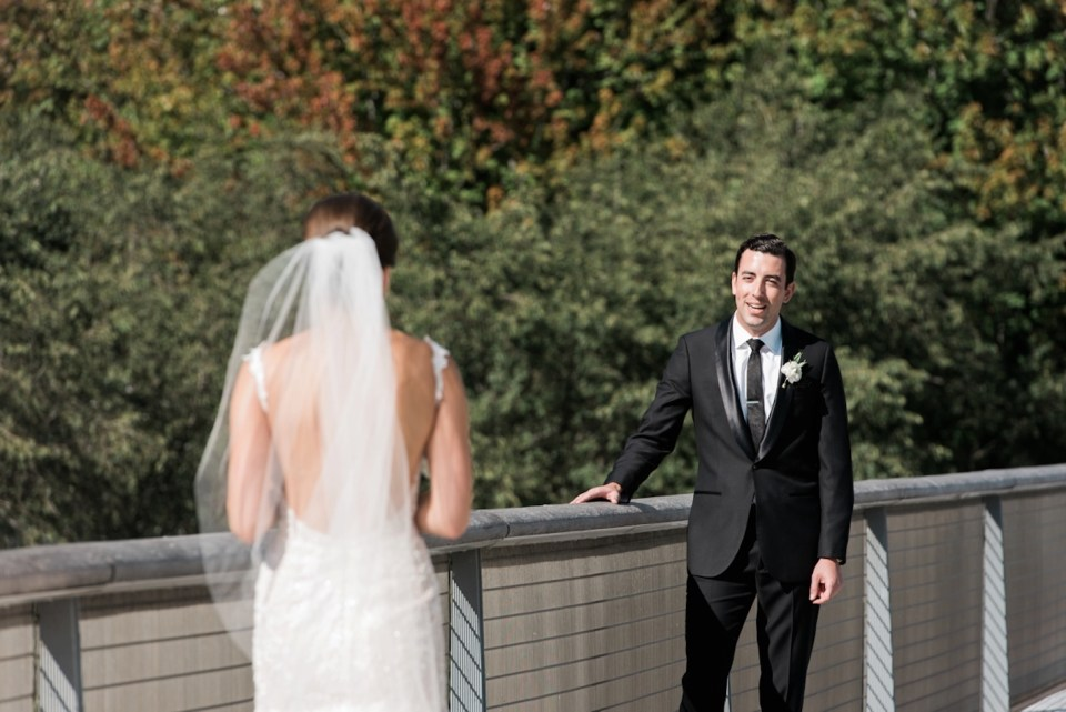 Groom sees bride for the first time on the Nichols Bridgeway in Chicago IL