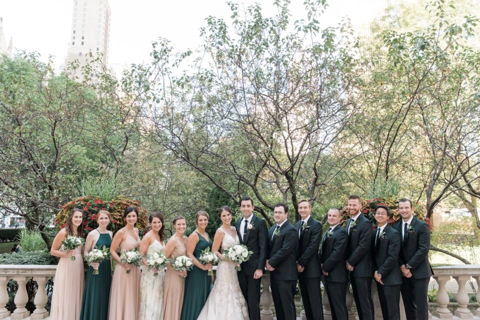 Wedding party poses for a photo in the Art Institute of Chicago North Gardens
