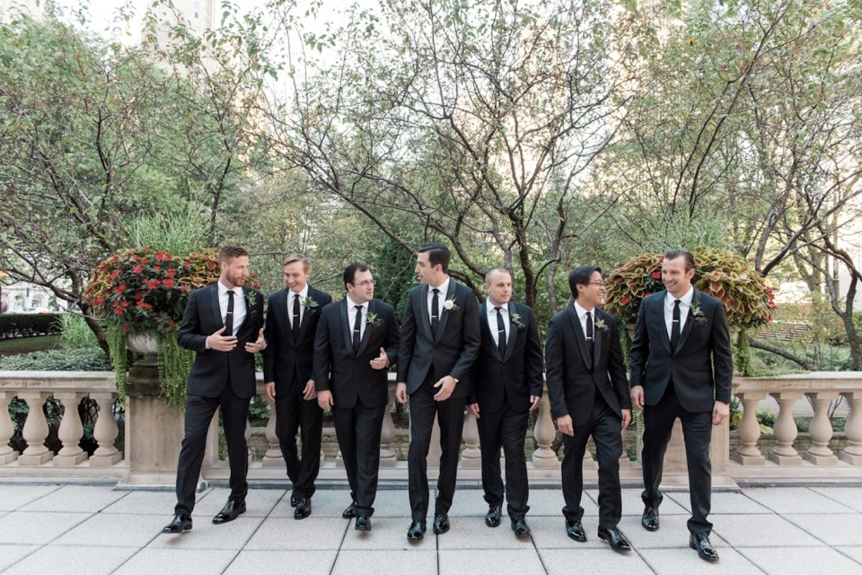 Candid photo of the groomsmen in the Art Institute of Chicago North Gardens