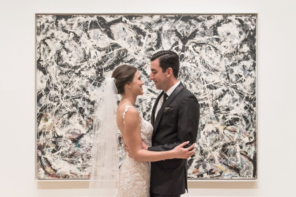 Bride and Groom in front of one of their favorite paintings at the