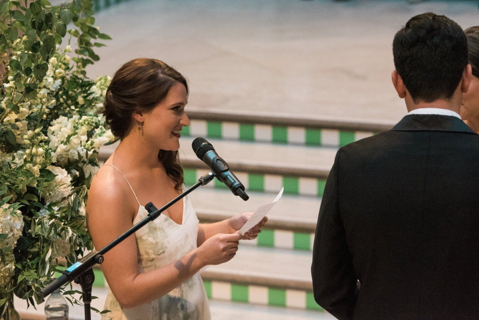 Bridesmaid gives a reading during the Grand Staircase wedding ceremony at the Art Institute of Chicago