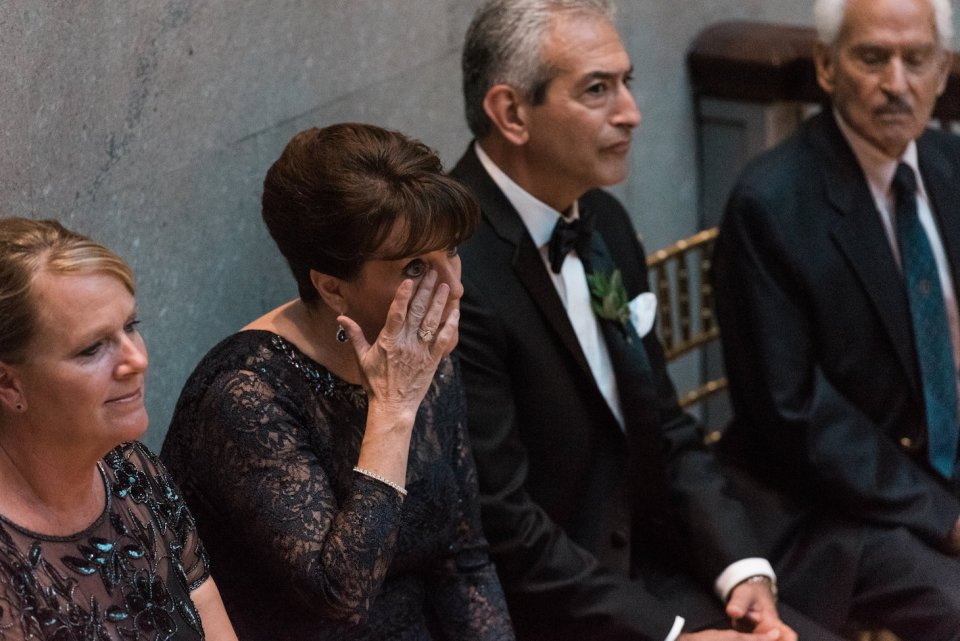 Mother of the Groom wipes away a happy tear during the Grand Staircase wedding ceremony at the Art Institute of Chicago