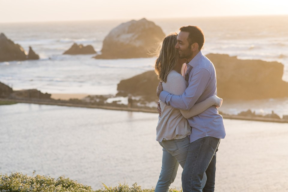 Couple kissing at sunset at Sutro Baths in San Francisco