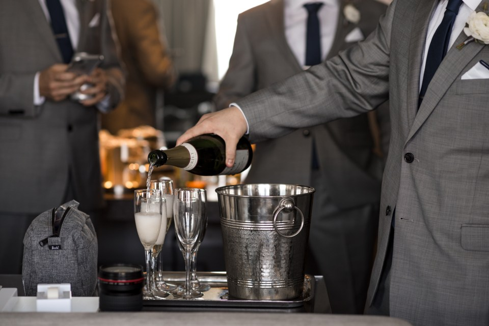 Groomsmen pouring champagne for a toast at the W Hotel Lakeshore