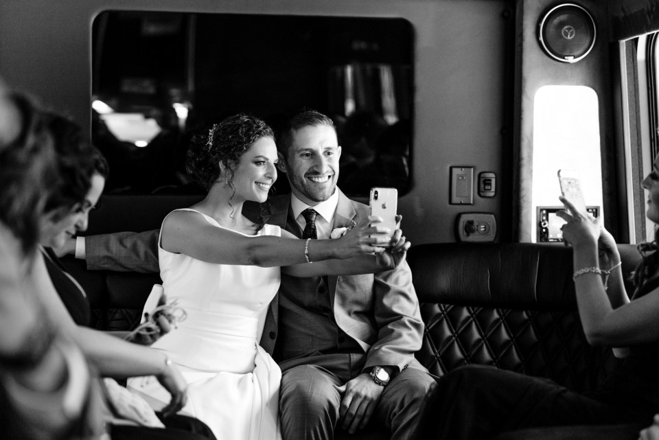 Couple snaps a selfie on a party bus in Chicago IL