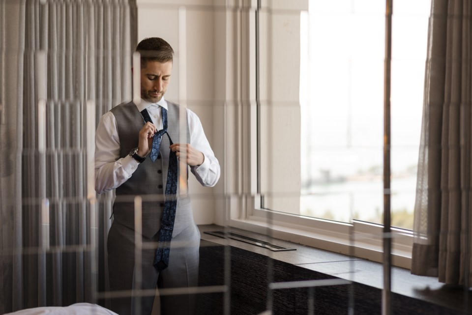 Groom getting ready on his wedding day at the W Hotel Lakeshore