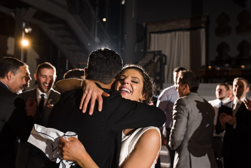 Bride gives her father a hug on the dance floor at Artifact Events