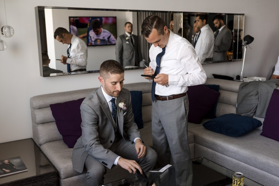 Groomsmen and Groom adjusting a watch at the W Hotel Lakeshore in Chicago IL