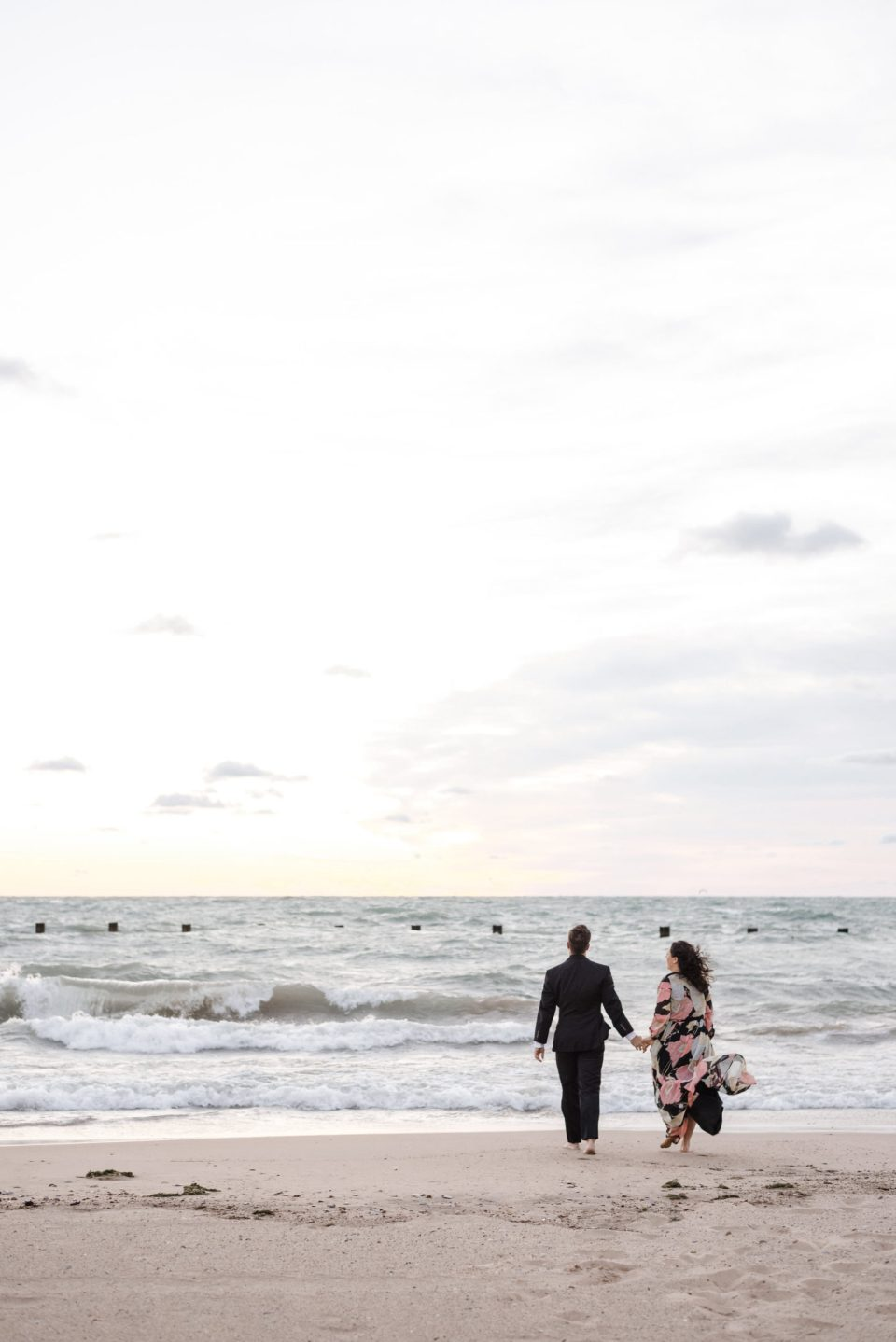 Couple walking toward the water on North Avenue Beach