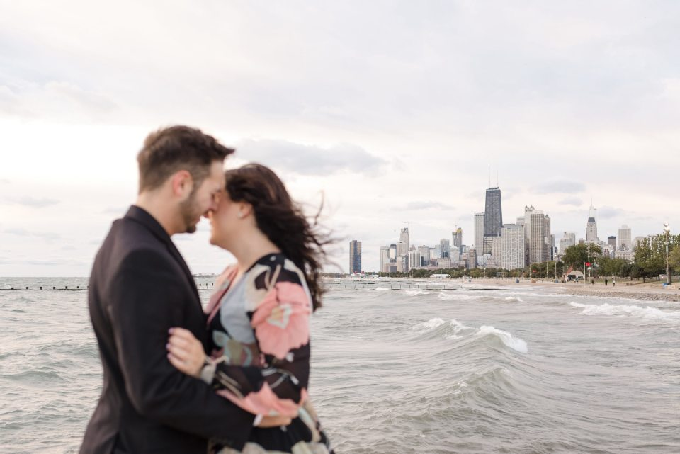 The Chicago skyline behind a couple on Fullerton Avenue Beach