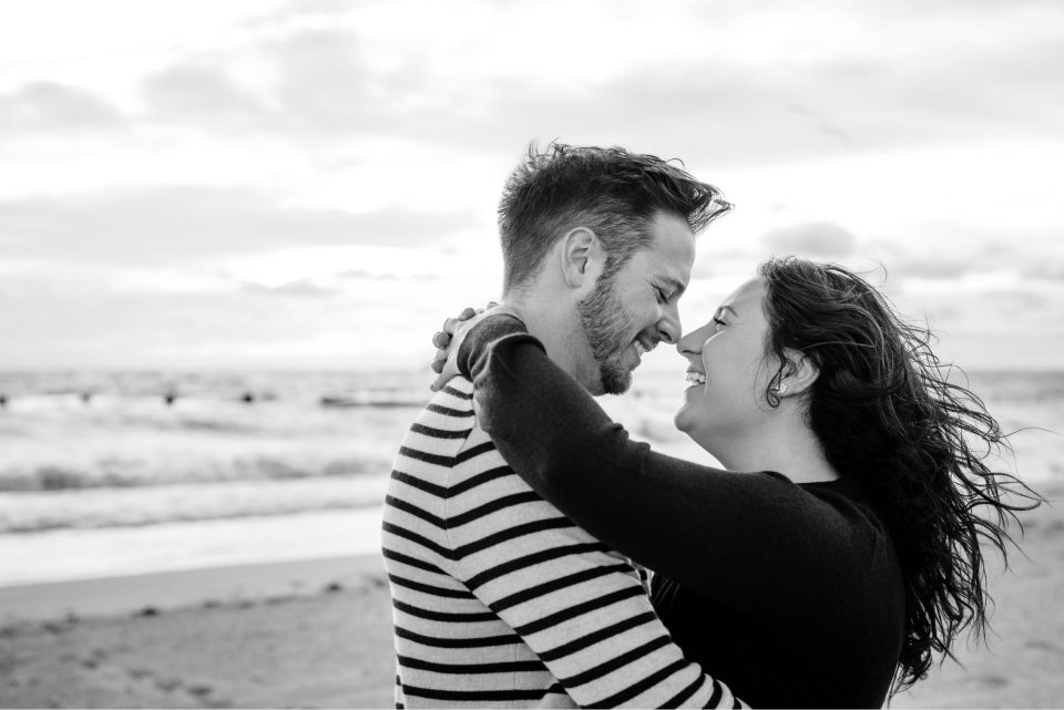 Couple looking lovingly at one another on the beach in Chicago Illinois