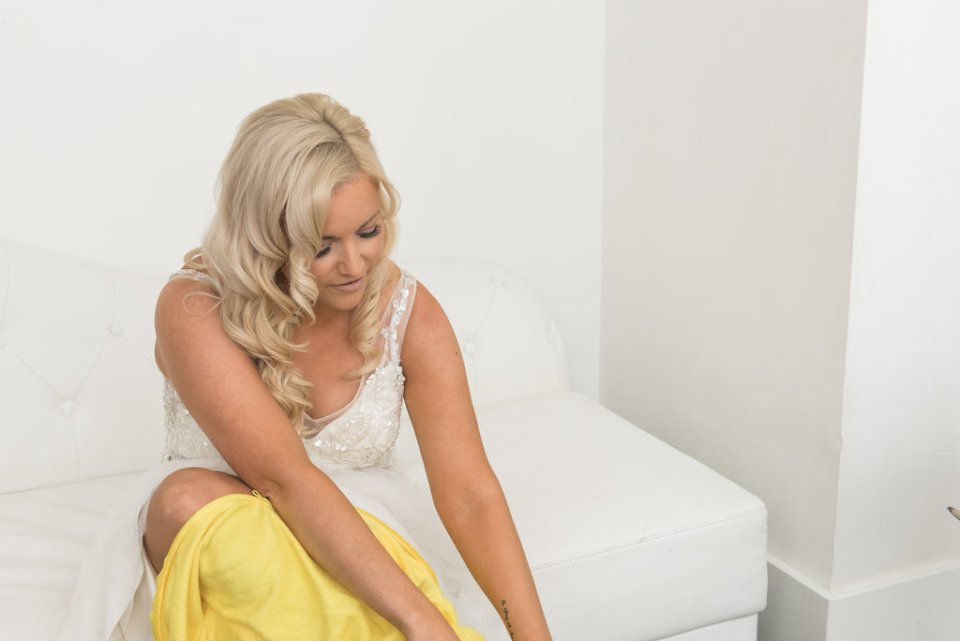 Bride puts a Pokemon onesie over her wedding dress