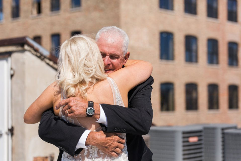 Bride has a first look with her dad on the rooftop of Room 1520